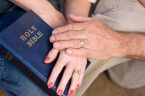 couple hands bible